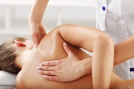 A picture of woman having back therapy